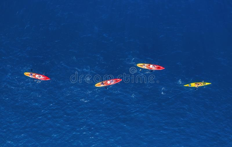 Croatia. Kayks at the sea surface. Aerial view of kyaks on blue Adriatic sea at sunny day. Adventure and travel. stock photos