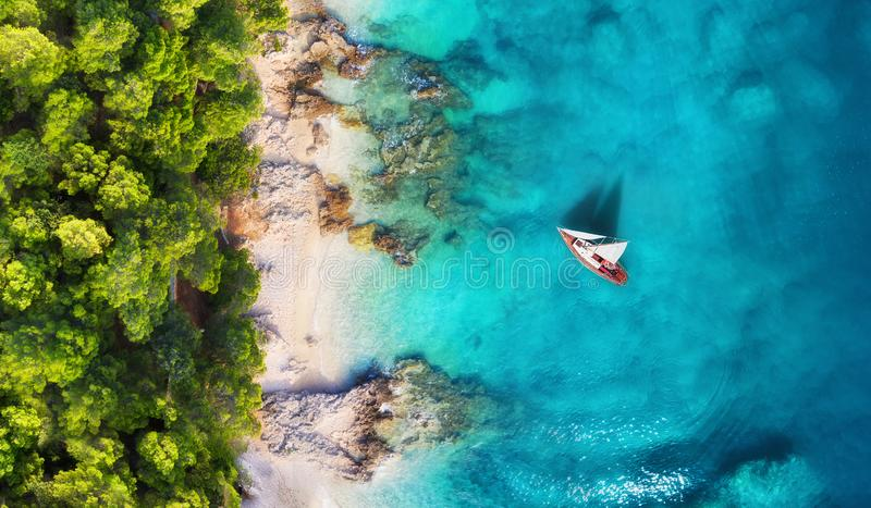 Croatia. Panoramic coast and yacht as a background from top view. Turquoise water background from top view. Beach and waves. royalty free stock image