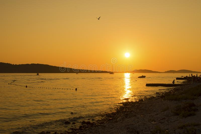 Croatia - Sunset on sea. Boat on sea stock photos