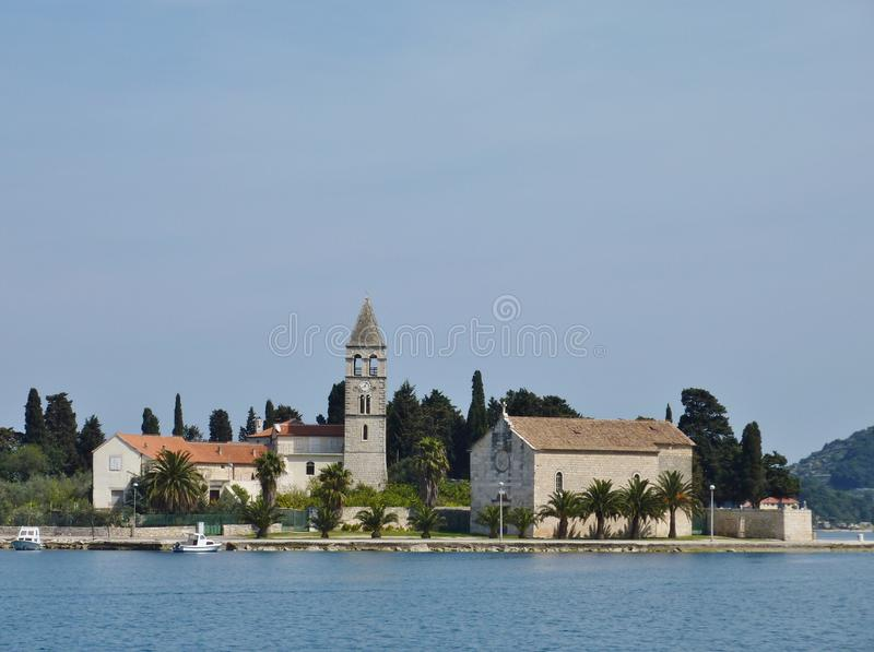 Croatian church at the bay of Vis. A monastery at the bay of Vis town at the Croatian island Vis in the Adriatic sea royalty free stock image