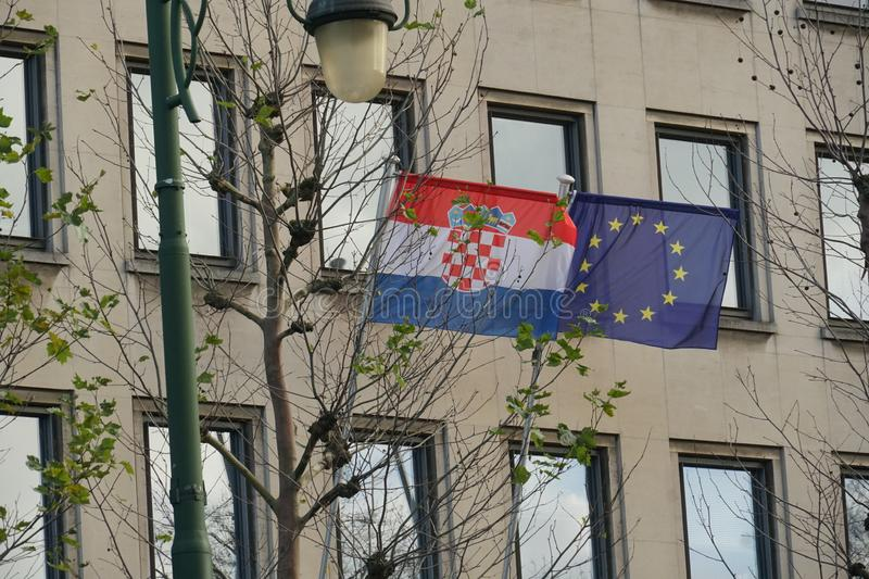 Croatian and European Union flags waving stock photos