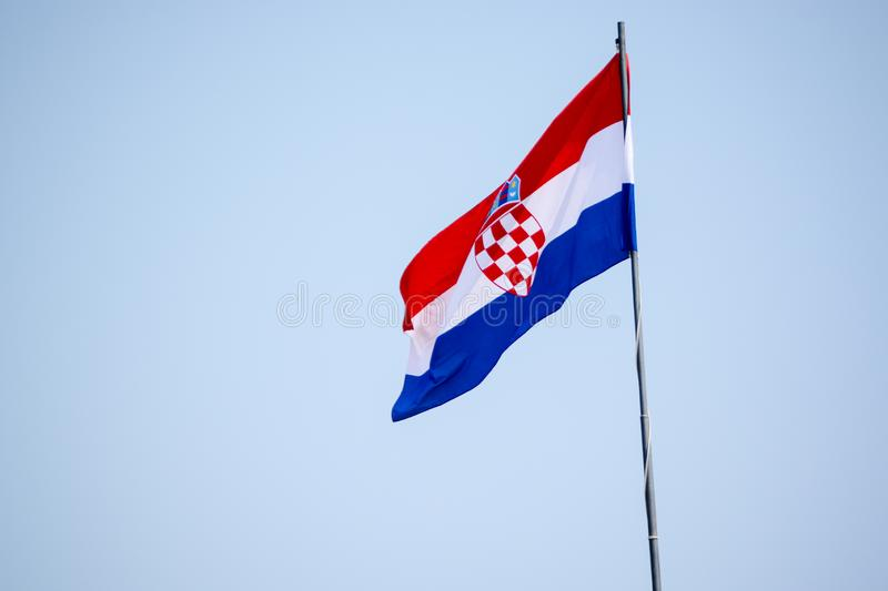 The Croatian Flag. And blue sky background stock photography