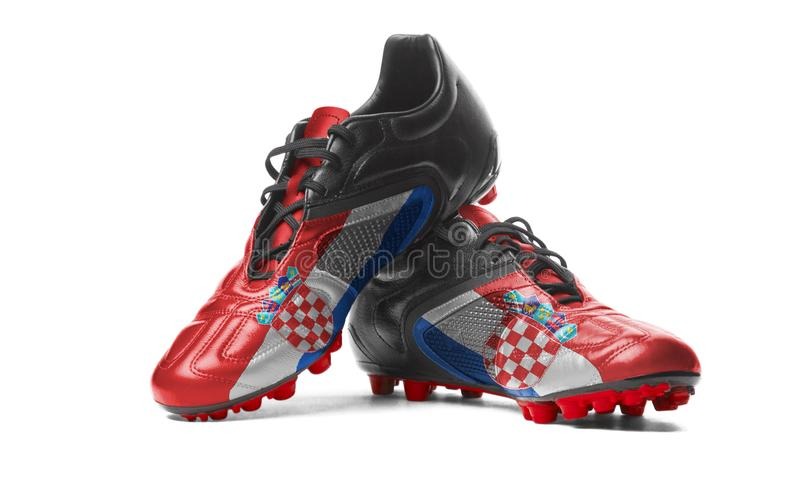 The Croatian flag. Painted on football boots. Isolated on white background stock images