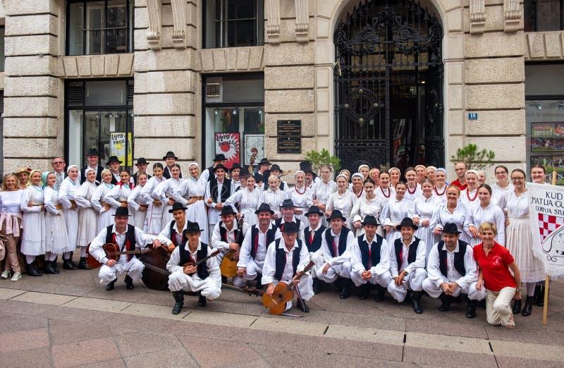 Croatian folklore dance ensemble make group photo outdoor. RIJEKA, CROATIA - SEPTEMBER 1, 2018: Croatian folklore dance ensemble make group photo outdoor royalty free stock photos