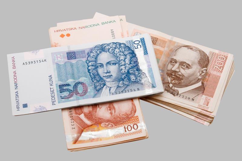 Croatian Kuna banknotes isolated on gray stock images