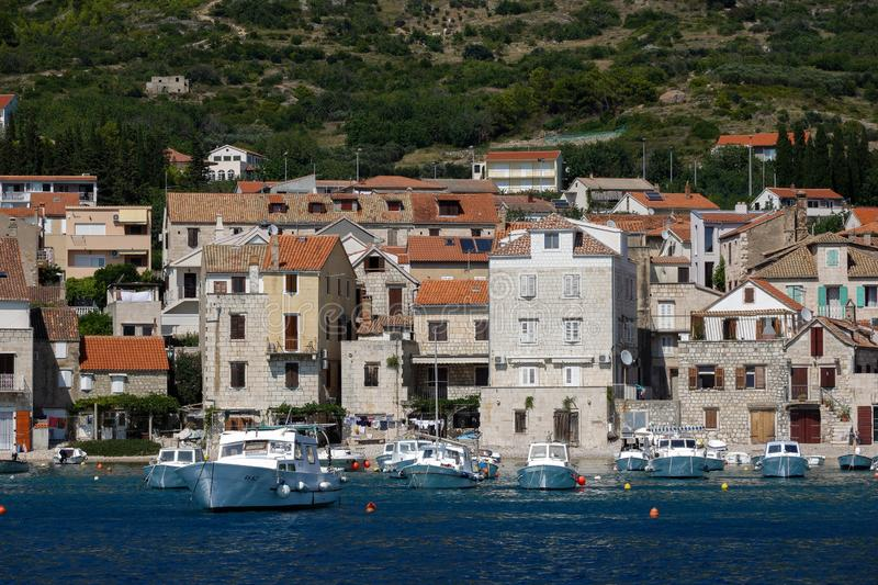 Croatian town Komiza on the island of Vis. Komiza, a Croatian town with 17th and 18th century stone town houses, on the western coast of the island of Vis, at royalty free stock photos