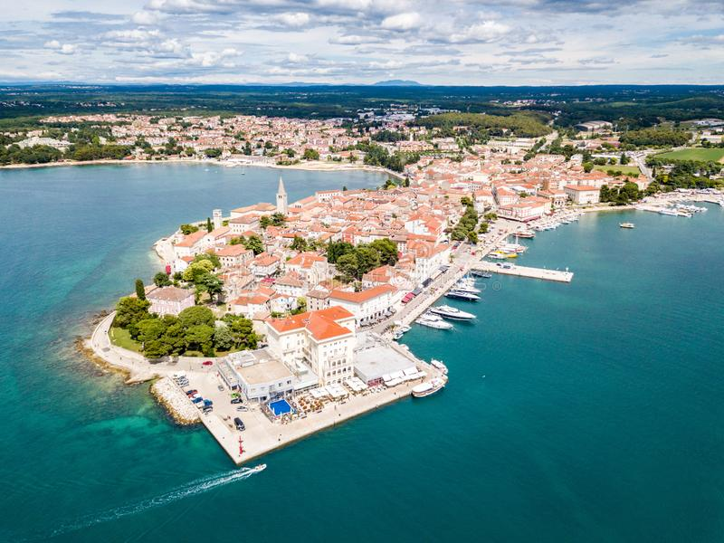 Croatian town of Porec, shore of blue azure turquoise Adriatic Sea, Istrian peninsula, Croatia. Bell tower, red tiled roofs. Croatian town of Porec, shore of stock photo