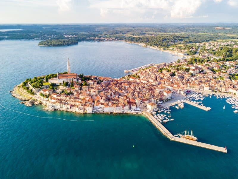 Croatian town of Rovinj on a shore of blue azure turquoise Adriatic Sea, lagoons of Istrian peninsula, Croatia. High bell tower. stock photo