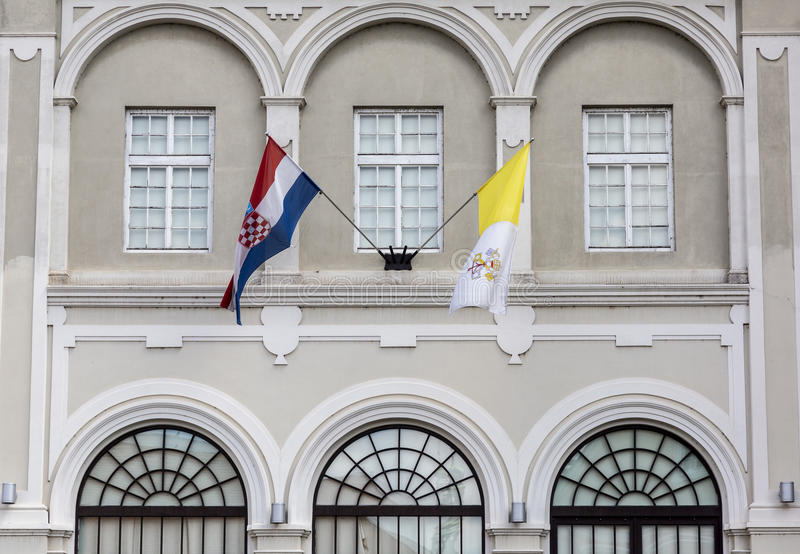 Croatian and Vatican flags. On display in Croatian capital Zagreb at the building that belongs to Catholic church royalty free stock images
