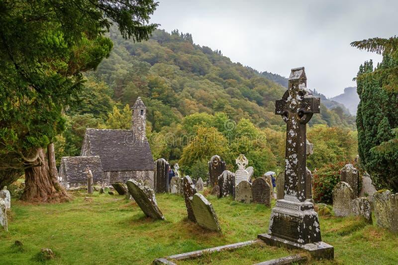 Croce celtica, Glendalough, Irlanda fotografia stock
