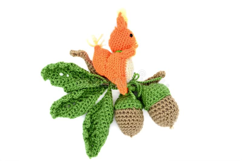 Crochet acorn oak tree leave with Squirrel on isolated white background royalty free stock photo