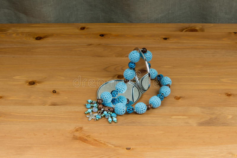 Crochet beads handmade with pendant starfish and hand mirror stock images