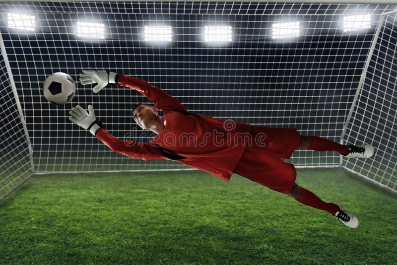 Crochet de gardien de but du football la boule image libre de droits