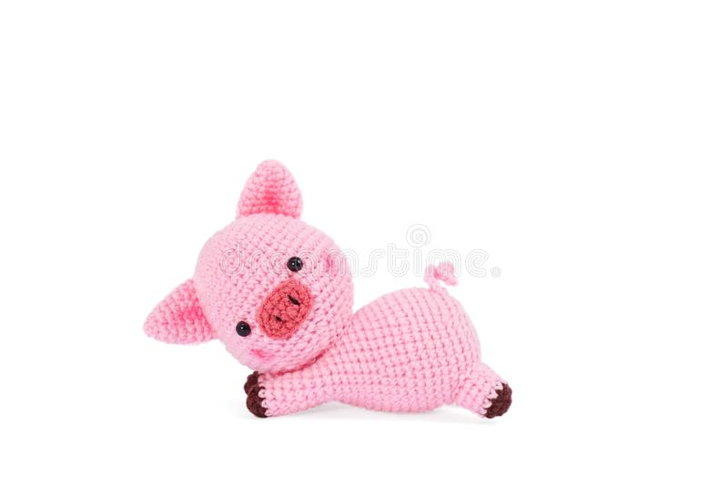 Crochet doll. Amigurumi or Crochet doll of a cute pig isolated on white background stock photography