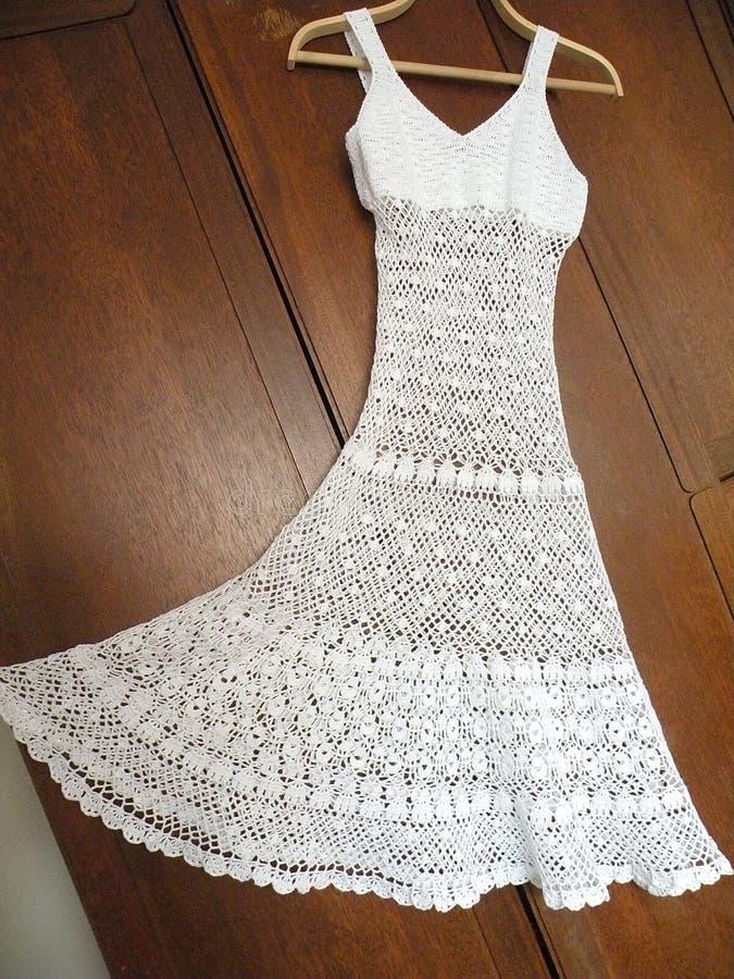 Crochet dress. Beautiful white crochet dress, craftsmanship stock image