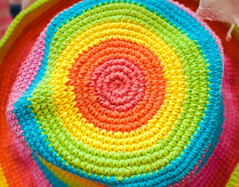 Crochet hat. A closed up pattern of a crochet hat in rainbow color. stock images
