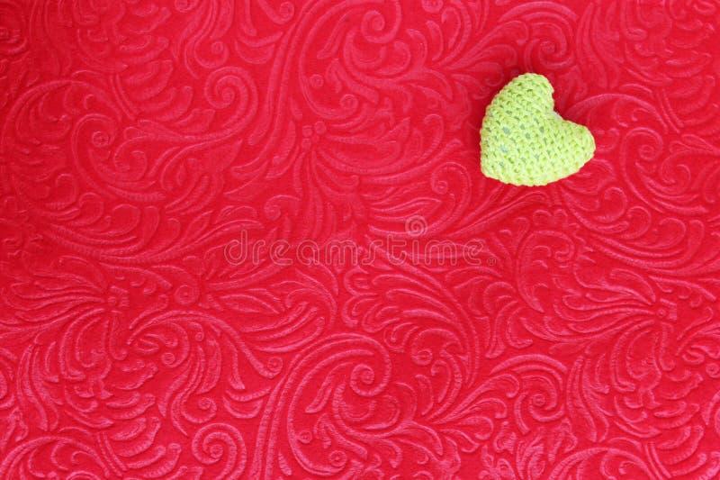 Crochet Heart on red velvet stock photo