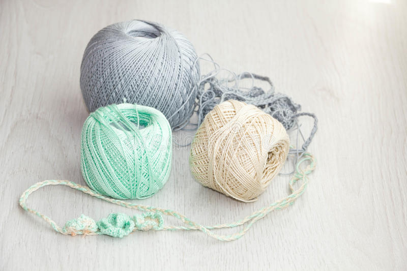 Crochet hooks and balls of yarn on wooden background. With copy space Basket with hue knitting yarns hobby handmade, tailor, hand sewing and knitting theme stock image