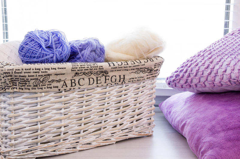 Crochet hooks and balls of yarn on wooden background. With copy space Basket with knitting yarns hobby handmade, tailor, hand sewing and knitting theme design stock images
