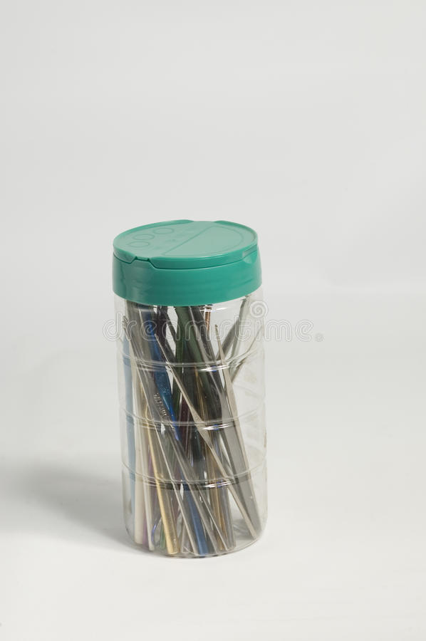 Crochet hooks. A container of crochet hooks of many sizes stock images