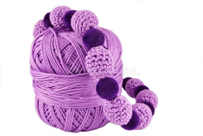 Crochet jewelry -purple beads stock photos