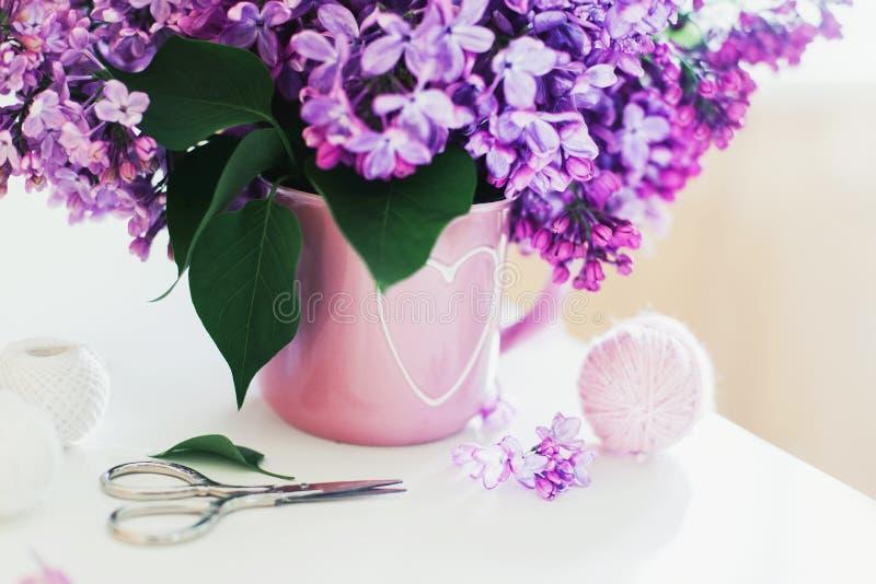 Bouquet of lilac, yarn, crochet hooks royalty free stock photo