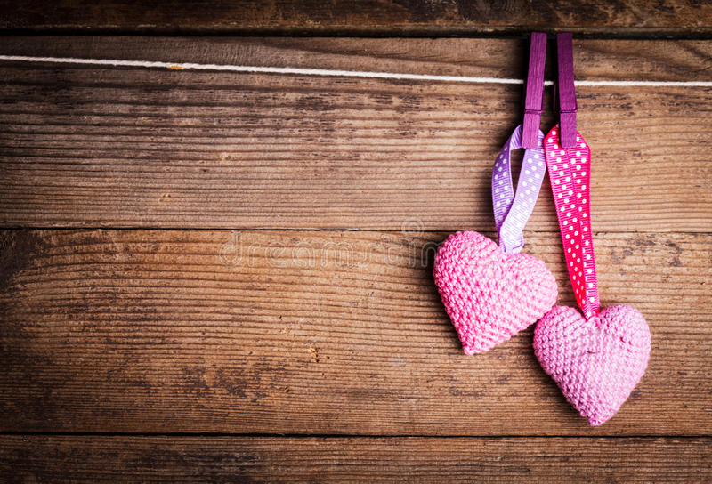 Crochet lovely hearts. Crochet valentine hearts handing on the rope. Valentine's day greeting card. Love concept royalty free stock photography
