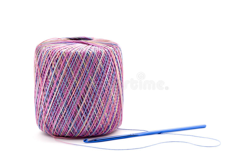 Crochet Thread with Hook. Crochet Thread ball with hook on white background royalty free stock image