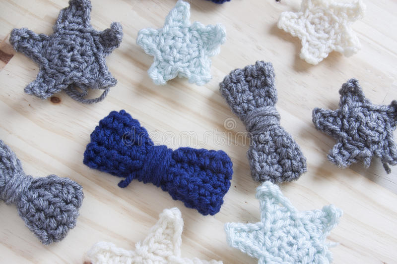 Crochet Yarn. Yarn crocheted into multiple stars and bows royalty free stock images