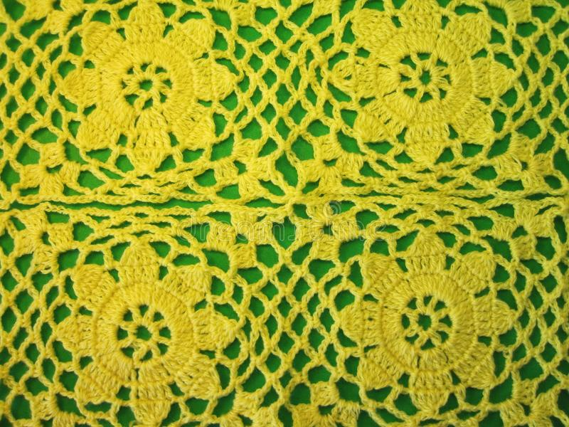 Crochet yellow flowers for woman dress royalty free stock photos