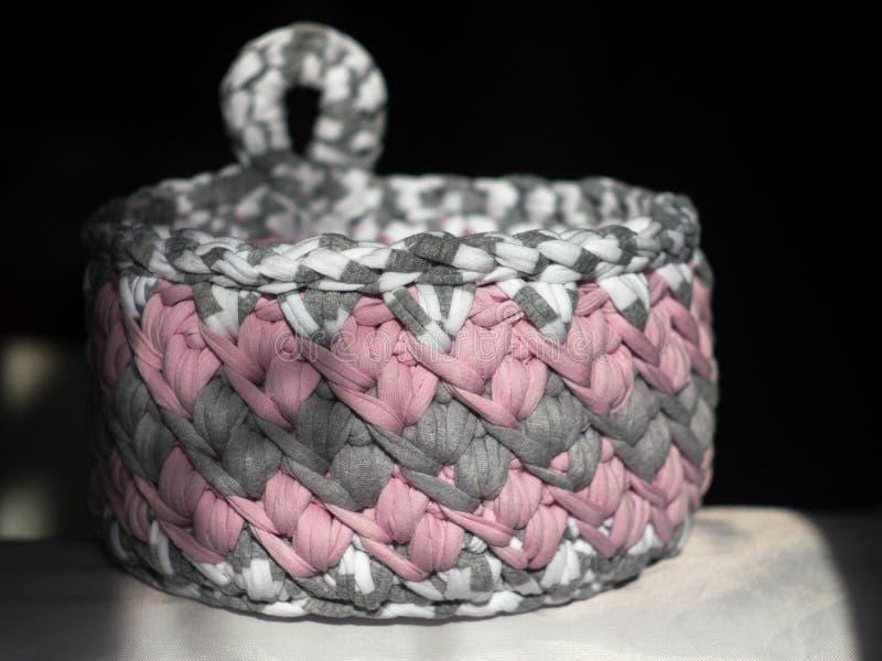 Crocheted basket crochet from knitting yarn. royalty free stock photos