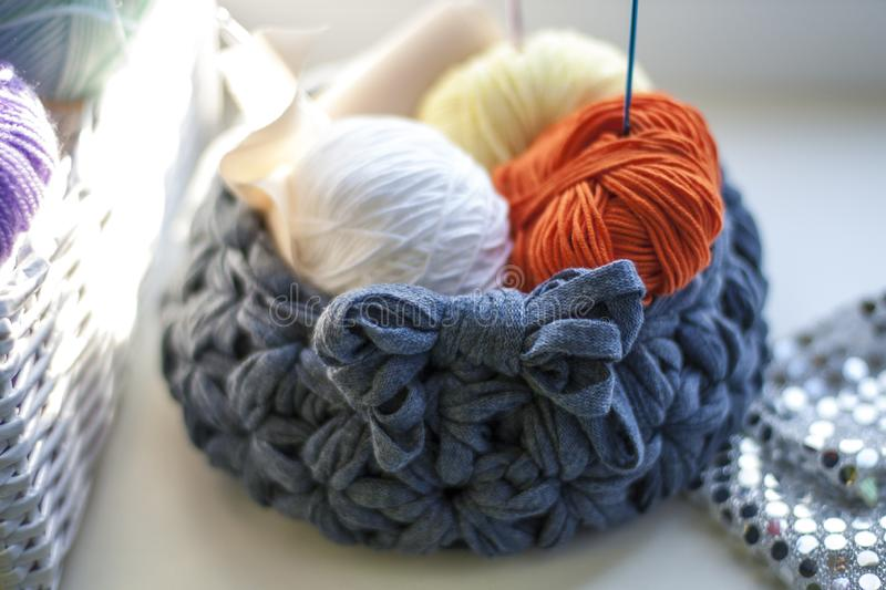 A crocheted basket with yarn stock photos