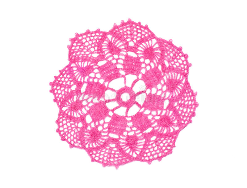 Crocheted doily. Old-fashioned little pink crocheted doily isolated in white royalty free stock image
