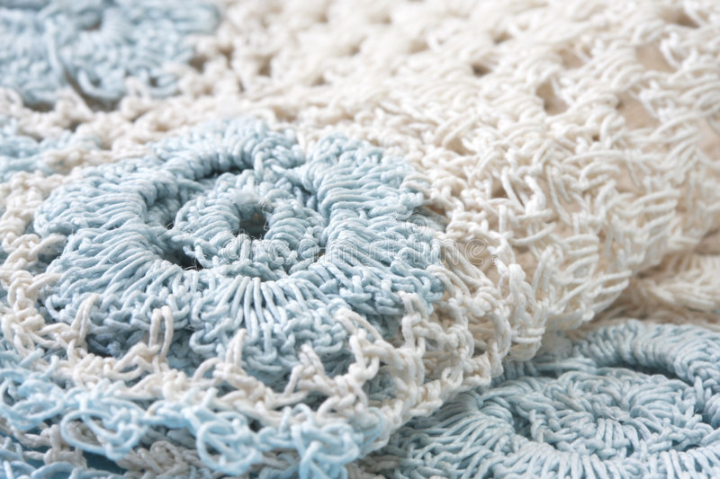 Crocheted Doily. In beige and pastel blue. Close-up view of this lovely handcraft royalty free stock photography