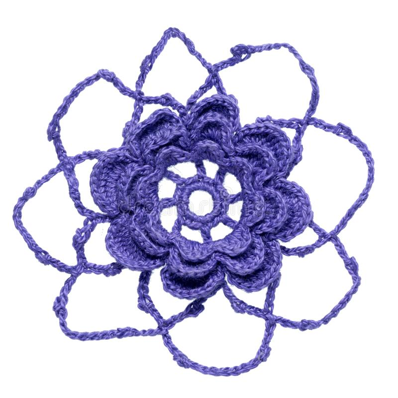 Crocheted flower. One crocheted flower element isolated on white background stock image