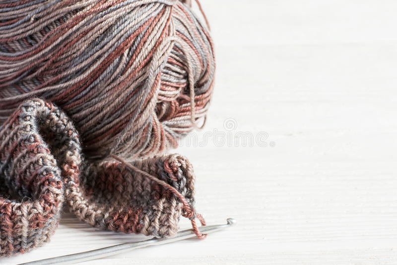 Crocheted handmade background. Knitted fabric in Gray winter ton royalty free stock photography