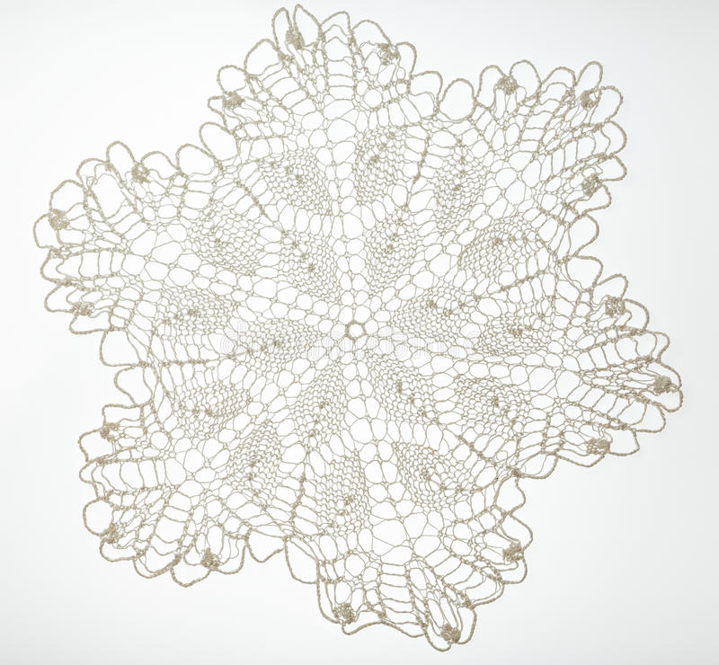 Crocheted lace on white. Crocheted lace napkin as home decoration on white stock image