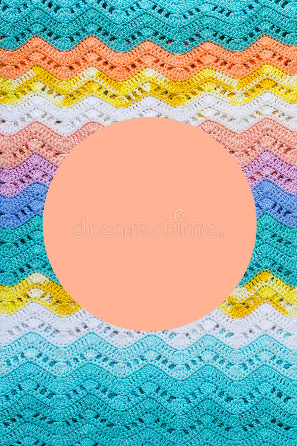 Crocheted multicolored cotton canvas. Round pink frame for text. royalty free stock image