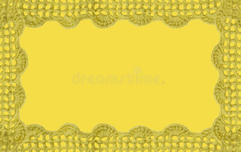 Yellow lace. Crocheted yellow lace on a golden background royalty free stock photos