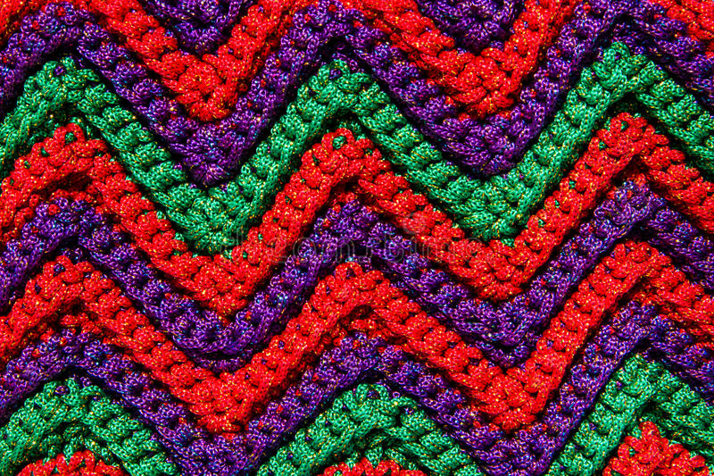 Crocheting pattern. Colorful crocheting pattern close up background stock photos