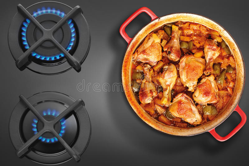 Crock on the gas stove. Top view royalty free stock photo