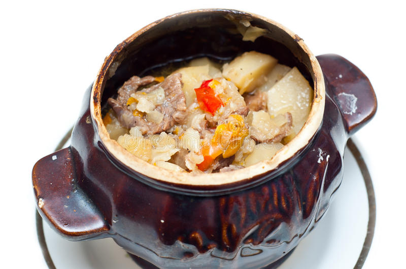 Crock pot full of beef and potato soup. Crock pot full of traditional soup with chunks of beef and potatoes stock image