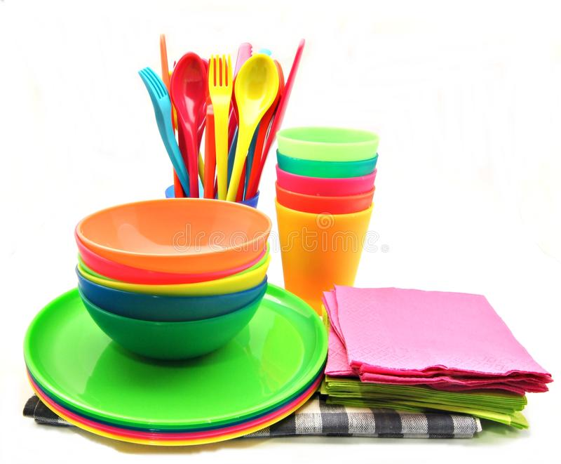 Crockery color. With colored napkins on a cloth, surrounded by white background stock images