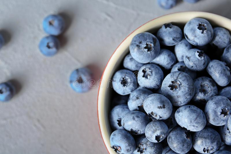 Crockery with juicy and fresh blueberries royalty free stock photo