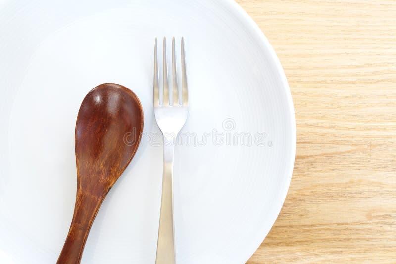 Crockery, kitchen. On wooden plate stock image