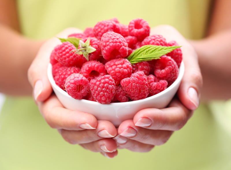 Crockery with raspberries.
