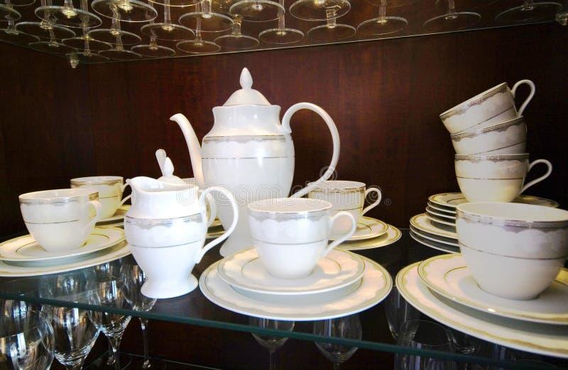 Crockery set. A set of crockery, elegant china in a cupboard royalty free stock photography