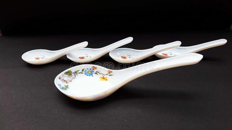 Crockery spoon isolated on black background close image. Domestic, food, kitchen, kitchenware, household, home, meal, cookery, tradition, decoration, weigh stock photo