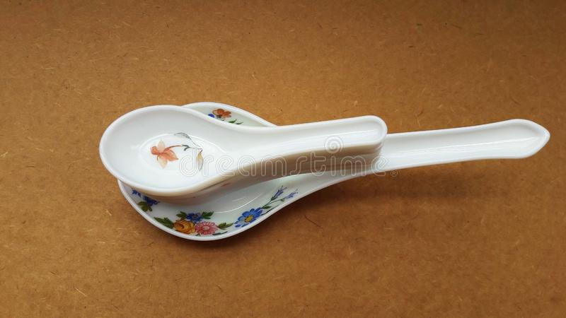 Crockery spoon isolated on brown background close image. Domestic, food, kitchen, kitchenware, household, home, meal, cookery, tradition, decoration, weigh stock photography