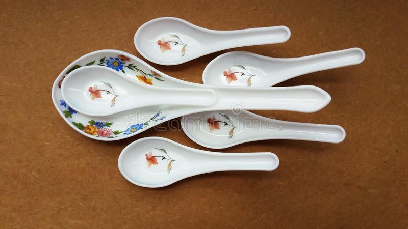 Crockery spoon isolated on brown background close image. Domestic, food, kitchen, kitchenware, household, home, meal, cookery, tradition, decoration, weigh royalty free stock photography